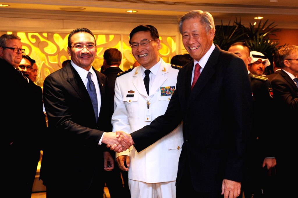 SINGAPORE, June 4, 2016 - Singapore's Minister for Defence Ng Eng Hen (R, front) shakes hands with Malaysian Defence Minister Hishammuddin Hussein (L, front) during the lunch of the 15th Shangri-La ... - Hishammuddin Hussein