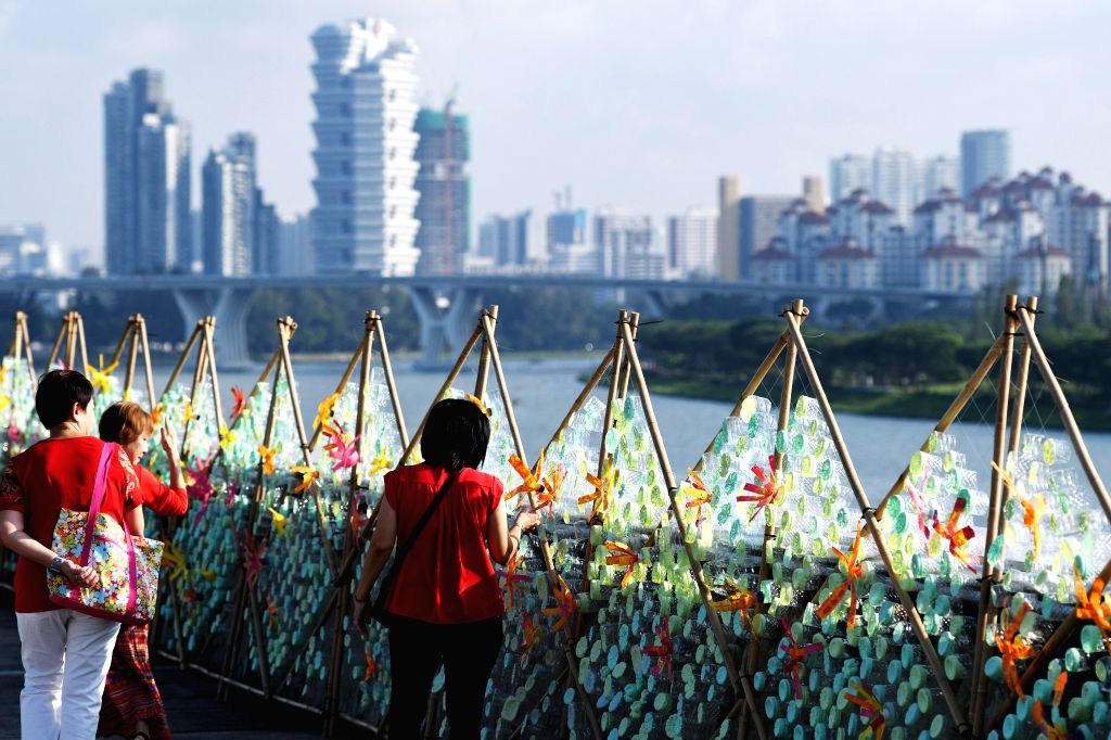 SINGAPORE, June 5, 2018 - A 120 metre-long art installation made of disposed plastic bottles marks the World Environment Day in Singapore's Marina Barrage rooftop park on June 5, 2018.
