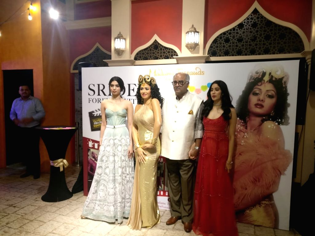 Singapore: Late Bollywood superstar Sridevi's husband Boney Kapoor and daughters Janhvi and Khushi with her wax statue that was unveiled at Madame Tussauds in Singapore on Sep 4, 2019. The statue is a replica of Sridevi's iconic look in th - Kapoor