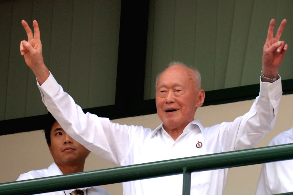 File photo taken on April 27, 2011 shows Singapore's former Prime Minister Lee Kuan Yew raising his arms in victory after being declared the winner of Tanjong ...