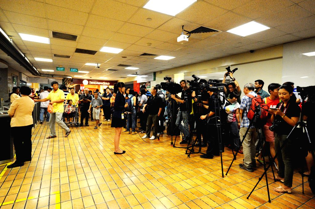 Journalists are seen at Singapore General Hospital where Singapore's Former Prime Minister Lee Kuan Yew is treated, on March 18, 2015. Lee Kuan Yew remains ...