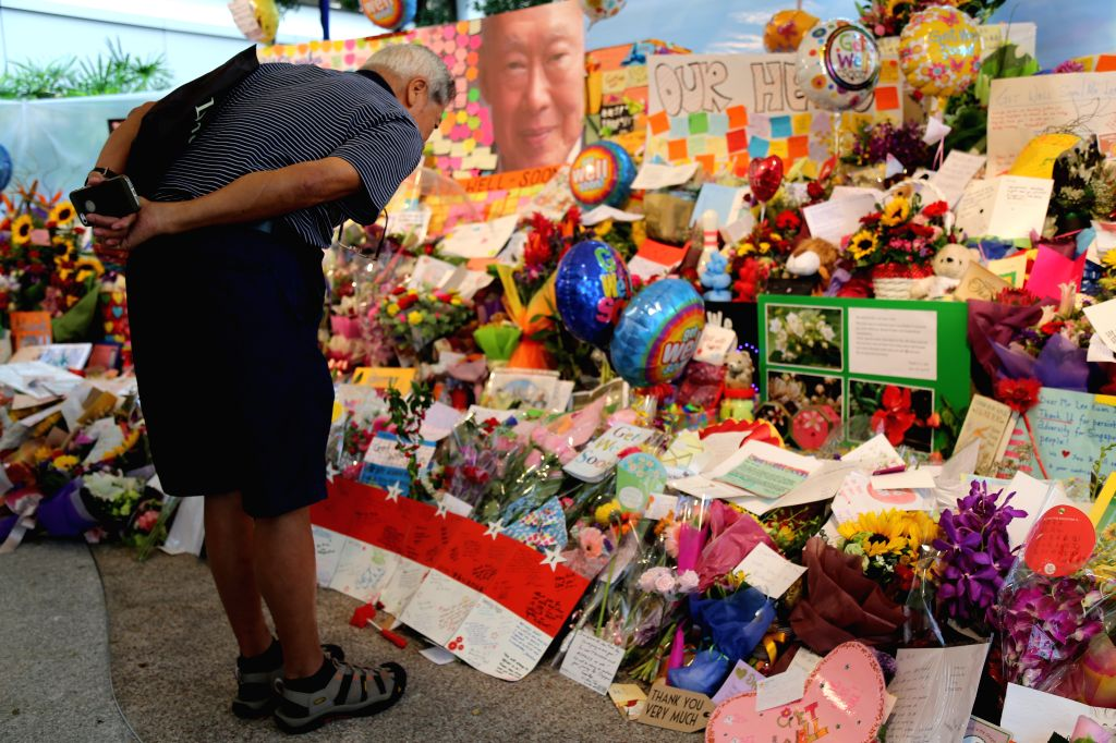 A man mourns over the death of Lee Kuan Yew, former prime minister of Singapore, at the central hospital of Singapore, March 23, 2015. Lee Kuan Yew died at 3:18 ...