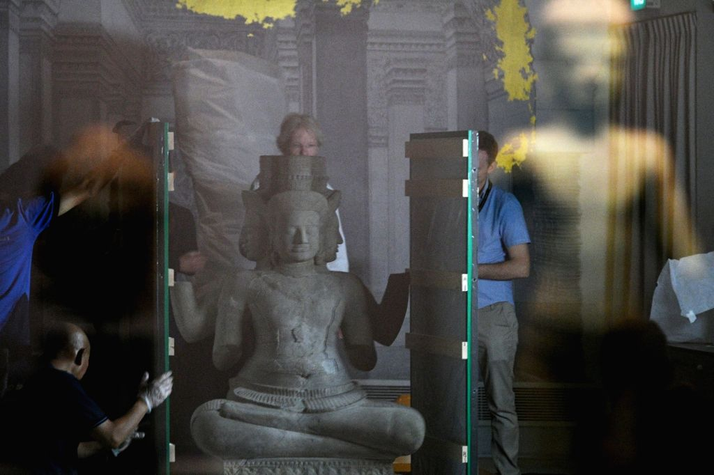 "SINGAPORE, March 26, 2018 - People work for the upcoming ""Angkor: Exploring Cambodia's Sacred City"" exhibition in Singapore's Asian Civilisations Museum on March 26, 2018. The exhibition ..."