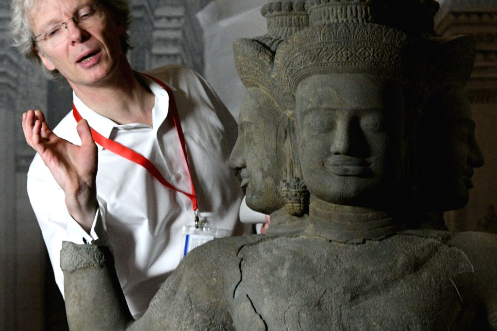 "SINGAPORE, March 26, 2018 - Pierre Baptiste from France's Guimet Museum works for the upcoming ""Angkor: Exploring Cambodia's Sacred City"" exhibition in Singapore's Asian Civilisations ..."