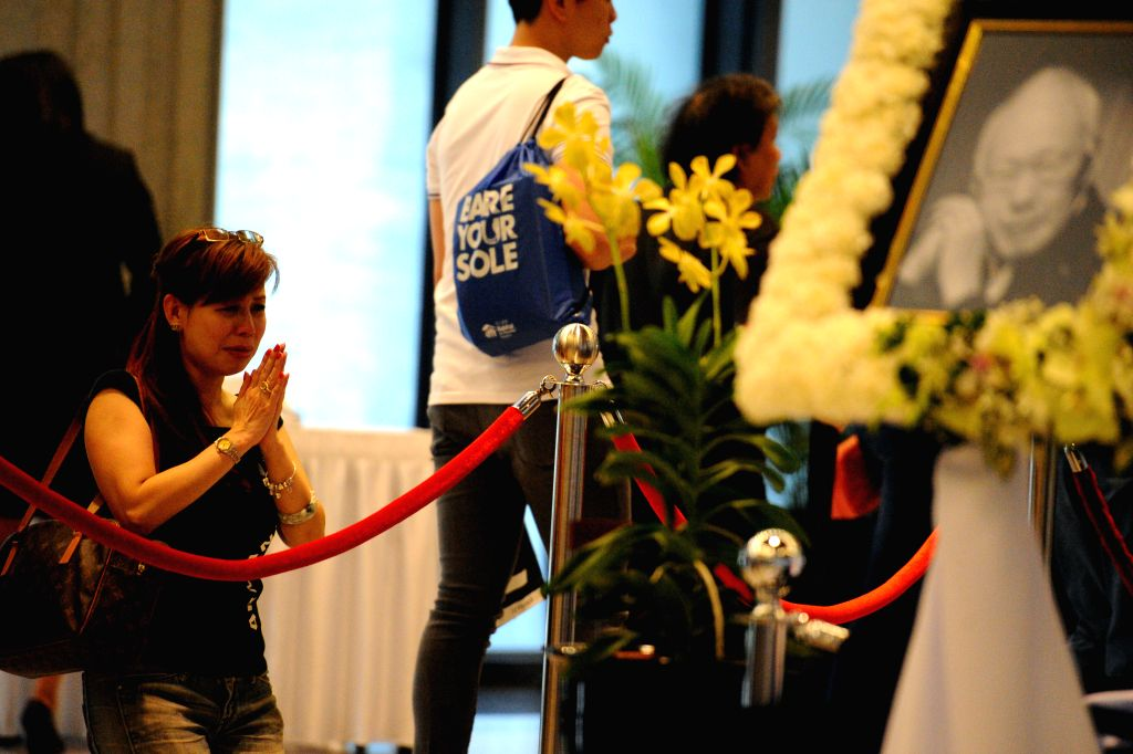 A woman pays her last respects to Singapore's former Prime Minister Lee Kuan Yew in Singapore's Parliament House, March 27, 2015. Singapore's founding Prime ...