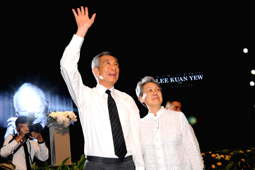 Singapore's Prime Minister Lee Hsien Loong (L, front) and his wife Ho Ching (R, front) attend a memorial meeting of Singapore's founding father Lee Kuan Yew at ... - Lee Hsien Loong
