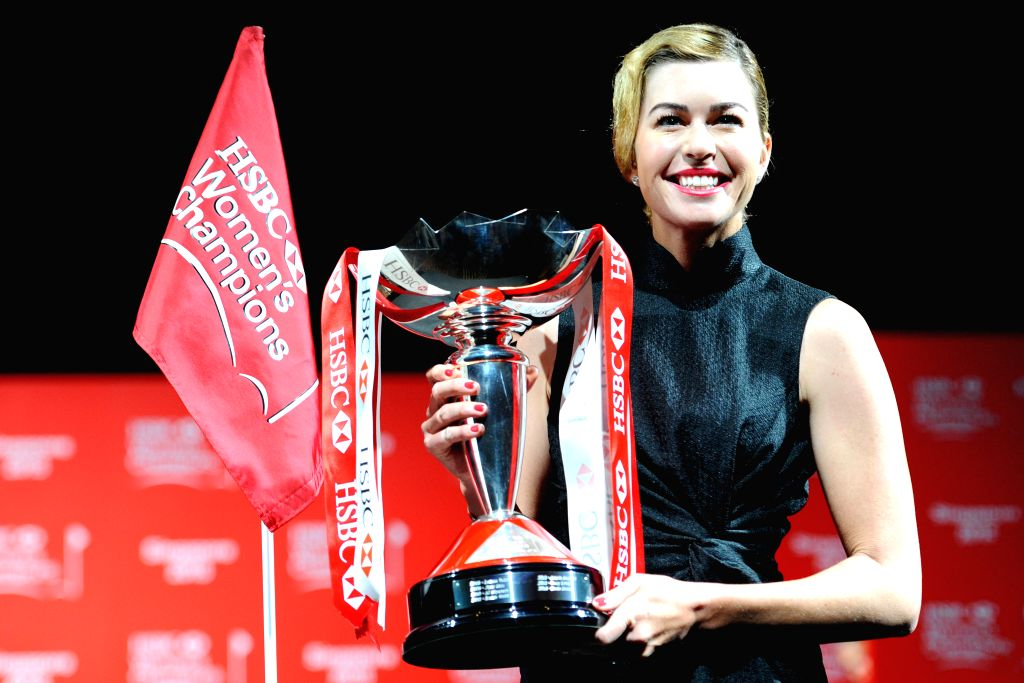 Paula Creamer of the U.S. poses with the trophy during a pre-competition event of HSBC Women's Champions golf tournament in Singapore, March 3, 2015. HSBC Women's ...