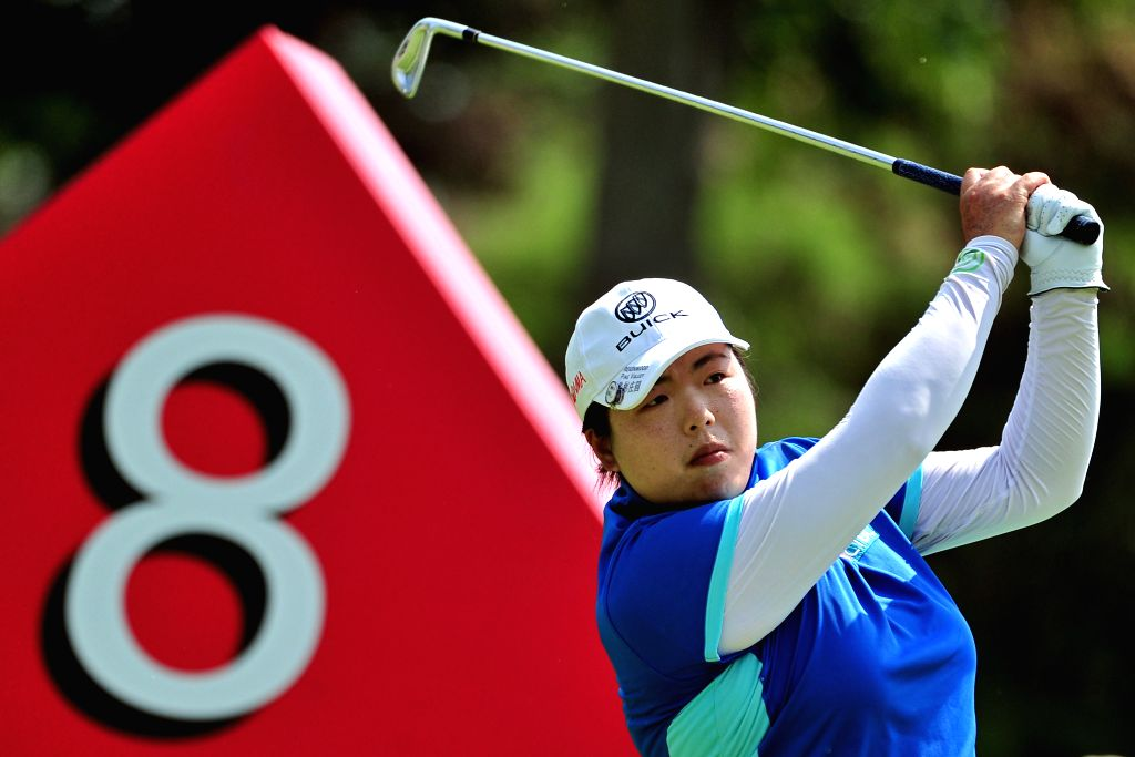 Feng Shanshan of China competes during the third day match of 2015 HSBC Women's Champions golf tournament at Singapore's Sentosa Golf Club Serapong Course, March ...