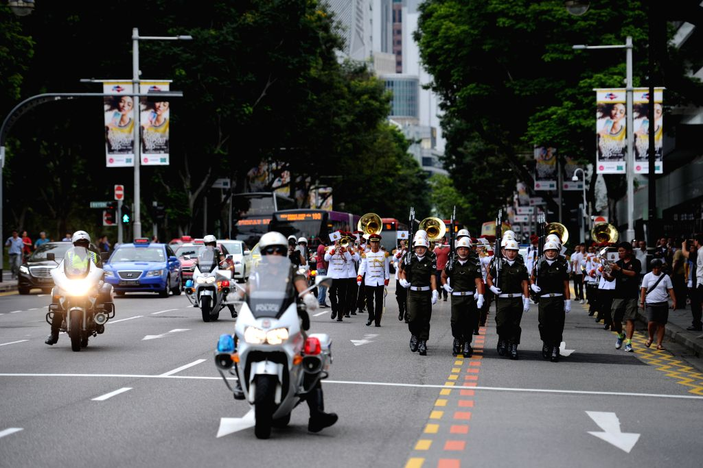Soldiers of the Singapore Armed Forces (SAF) Military Police Command march along Orchard Road during the change of Guards ceremony outside the main gate of ...