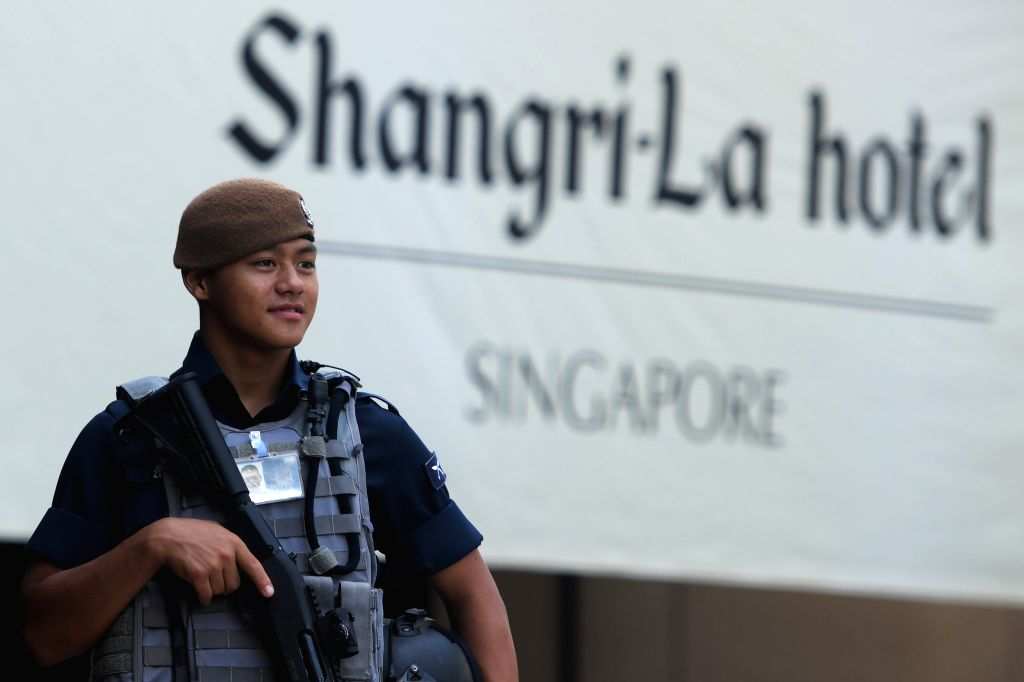 SINGAPORE, May 31, 2019 - A police officer stands guard ahead of the 18th Shangri-La Dialogue held at Singapore's Shangri-La Hotel on May 31, 2019. As the 18th Shangri-La Dialogue kicks off here ...