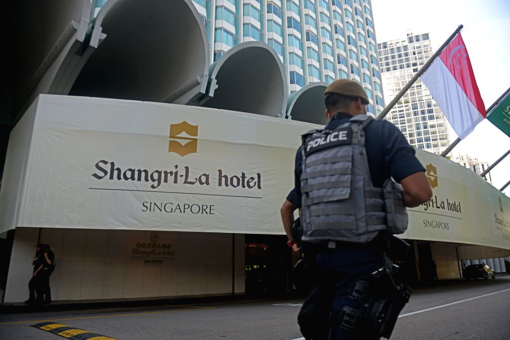 SINGAPORE, May 31, 2019 - Police officers stand guard ahead of the 18th Shangri-La Dialogue held at Singapore's Shangri-La Hotel on May 31, 2019. As the 18th Shangri-La Dialogue kicks off here ...