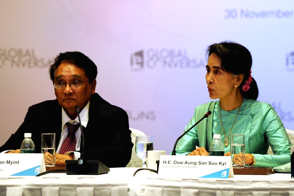 SINGAPORE, Nov. 30, 2016 - Myanmar's State Counsellor Aung San Suu Kyi (R) and Myanmar's Minister of Commerce Than Myint attend the IE Singapore Global Conversations held in Singapore, Nov. 30, 2016. ...