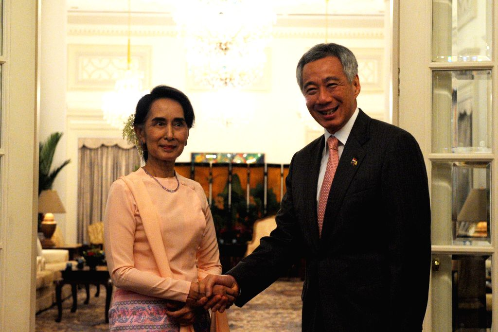 SINGAPORE, Nov. 30, 2016 - Singapore's Prime Minister Lee Hsien Loong (R) shakes hands with Myanmar State Counselor Aung San Suu Kyi at Singapore's Istana on Nov. 30, 2016. Aung San Suu Kyi began her ... - Lee Hsien Loong