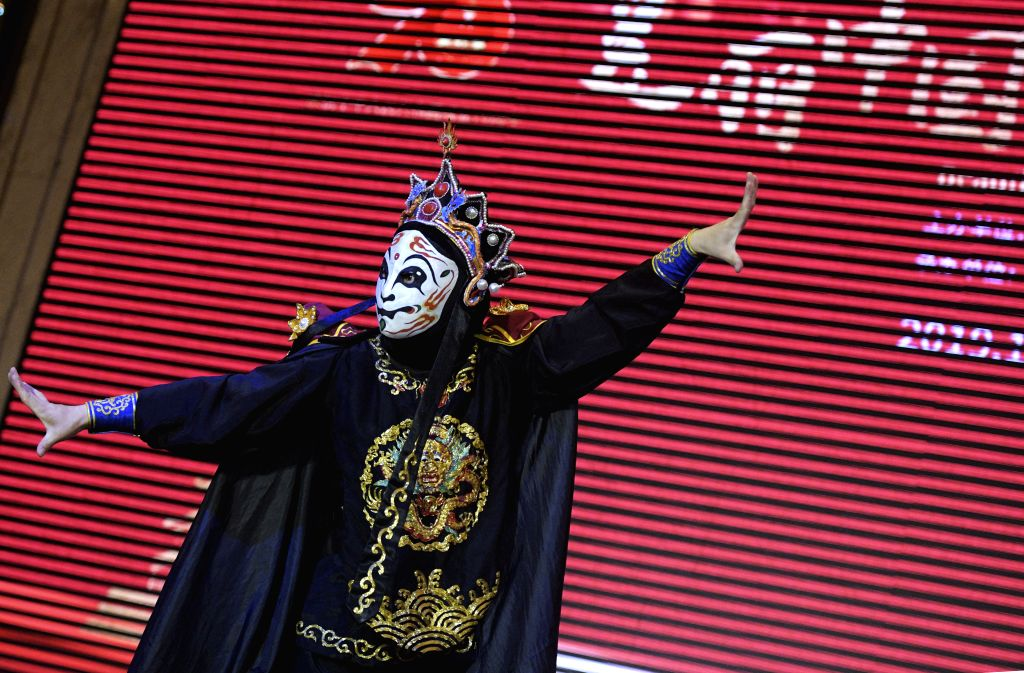 SINGAPORE, Oct. 16, 2019 - An actor performs traditional face change during the Beautiful China tourism promotion event held in Singapore on Oct 15, 2019. A total of 11 Chinese provinces and ...