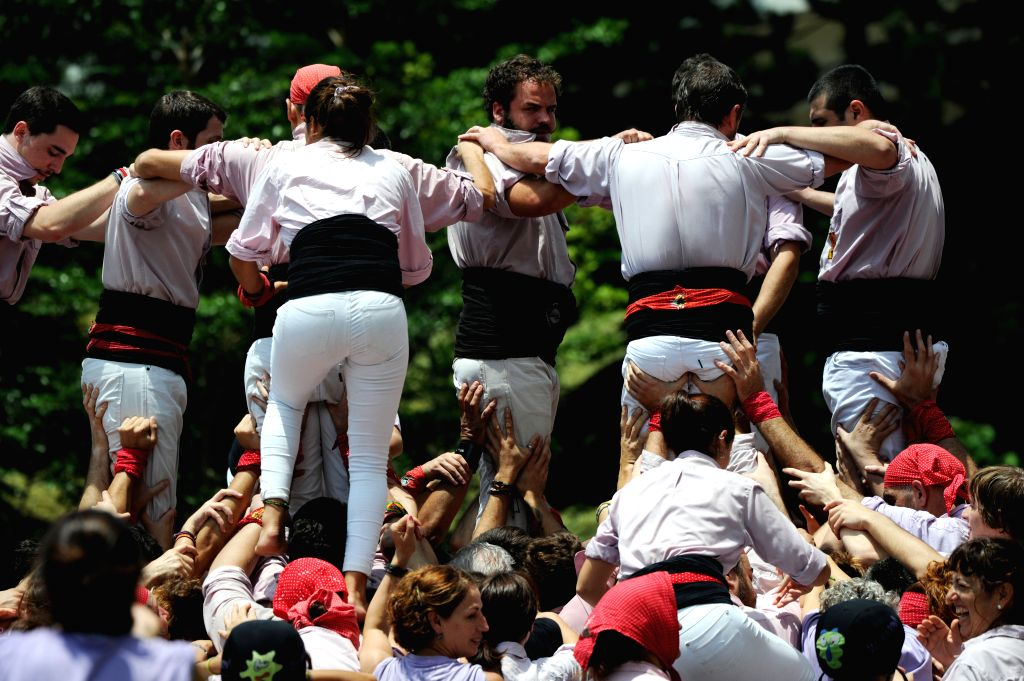 """SINGAPORE, Oct. 20, 2016 - Catalonian castellers form human towers during the """"Catalonia Week"""" at Singapore's Sentosa island on Oct. 20, 2016. The famous castellers from Minyons de Terrassa ..."""