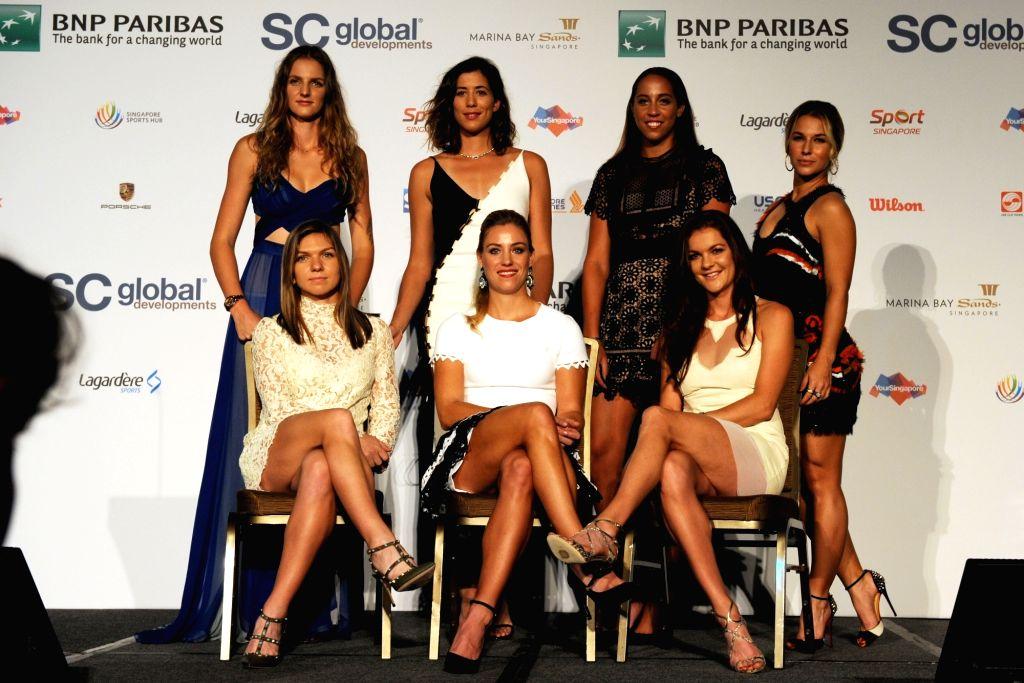 SINGAPORE, Oct. 21, 2016 - (L to R, rear) Karolina Pliskova of Czech Republic, Garbine Muguruza of Spain, Madison Keys of the United States, Dominika Cibulkova of Slovakia, (L to R, front) Simona ...