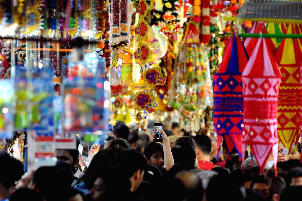 SINGAPORE, Oct. 22, 2016 - People shop at the Deepavali Festival market in Singapore's Little India, Oct. 22, 2016. Deepavali Festival, or Festival of Lights, will be celebrated in Singapore on Oct. ...