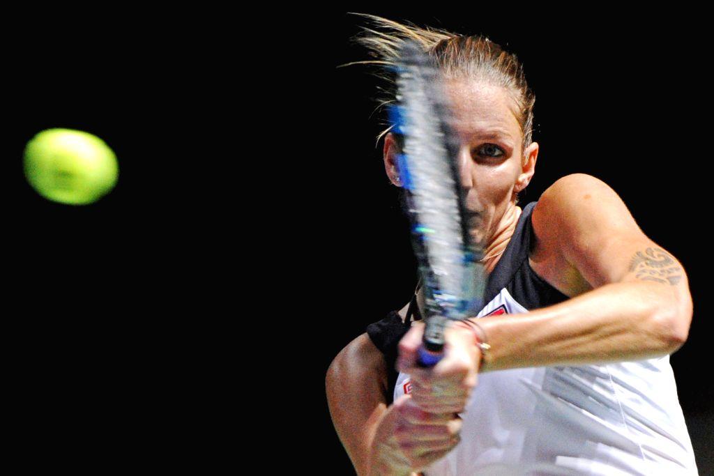 SINGAPORE, Oct. 26, 2016 - Czech Republic?s player Karolina Pliskova returns the ball during the WTA Finals round robin match at Singapore Indoor Stadium, Oct. 26, 2016. Karolina Pliskova lost to ...