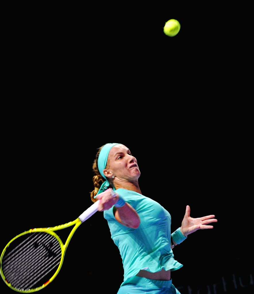 SINGAPORE, Oct. 26, 2016 - Russia?s player Svetlana Kuznetsova returns the ball during the WTA Finals round robin match at Singapore Indoor Stadium, Oct. 26, 2016. Karolina Pliskova lost to Svetlana ...