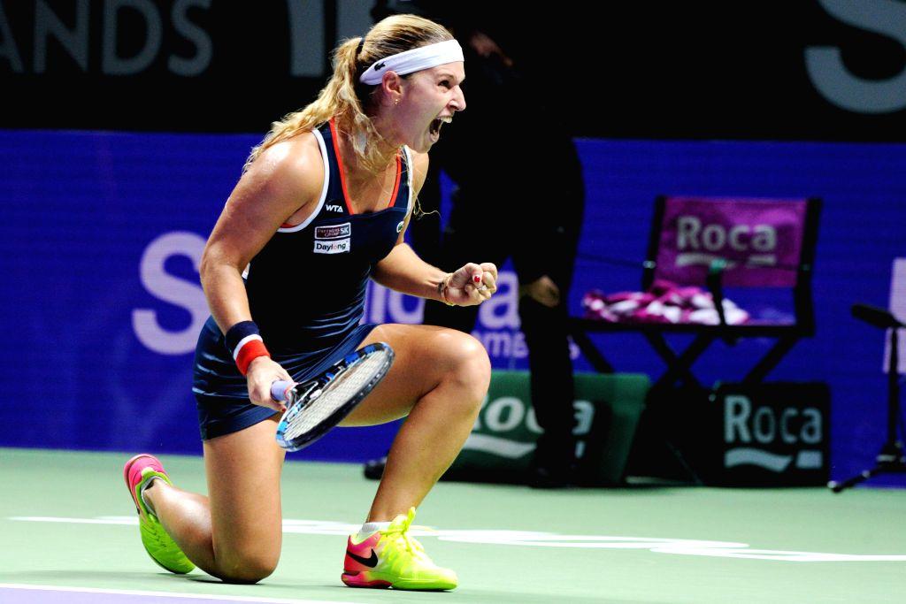 SINGAPORE, Oct. 27, 2016 - Dominika Cibulkova of Slovakia celebrates during a WTA Finals match against Simona Halep of Romania in Singapore, Oct. 27, 2016. Cibulkova won 2-0.