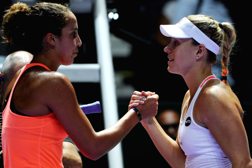 SINGAPORE, Oct. 27, 2016 - Germany?s player Angelique Kerber (R) shakes hands with the United States' player Madison Keys after the WTA Finals round robin match at Singapore Indoor Stadium, Oct. 27, ...