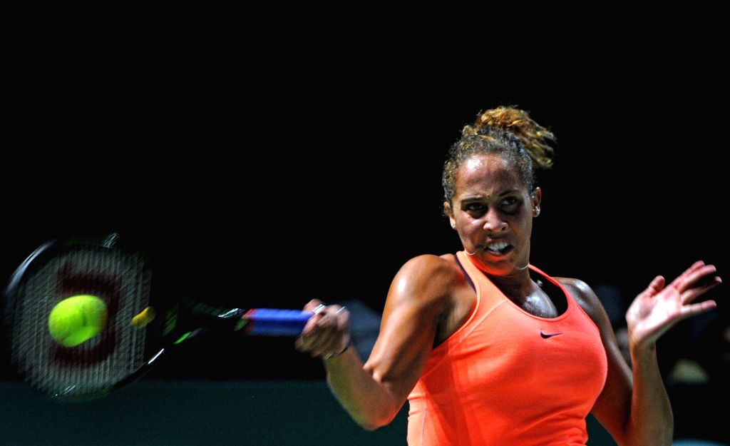 SINGAPORE, Oct. 27, 2016 - The United States' player Madison Keys returns the ball during the WTA Finals round robin match against Germany?s player Angelique Kerber at Singapore Indoor Stadium, Oct. ...