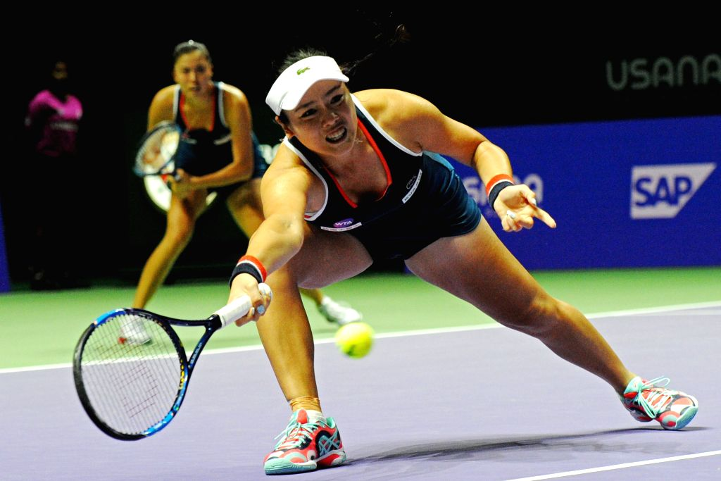 SINGAPORE, Oct. 28, 2016 - Chan Yung-Jan (Front) and Chan Hao-Ching of Chinese Taipei compete during the WTA Finals elimination match against Martina Hingis of Switzerland and Sania Mirza of India at ... - Martina Hingis and Sania Mirza