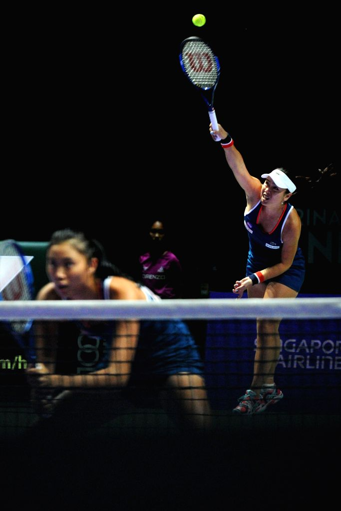SINGAPORE, Oct. 28, 2016 - Chan Yung-Jan (R) and Chan Hao-Ching of Chinese Taipei compete during the WTA Finals elimination match against Martina Hingis of Switzerland and Sania Mirza of India at ... - Martina Hingis and Sania Mirza