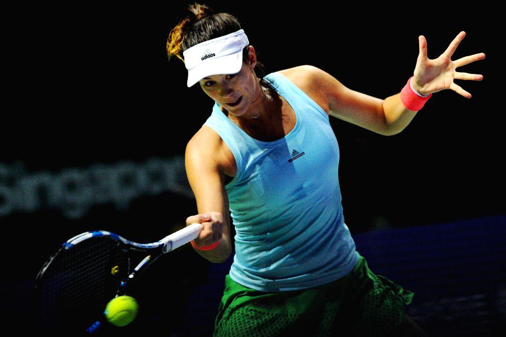 SINGAPORE, Oct. 28, 2016 - Garbine Muguruza of Spain competes during the WTA Finals round robin match against Svetlana Kuznetsova of Russia at Singapore Indoor Stadium, Oct. 28, 2016. Garbine ...
