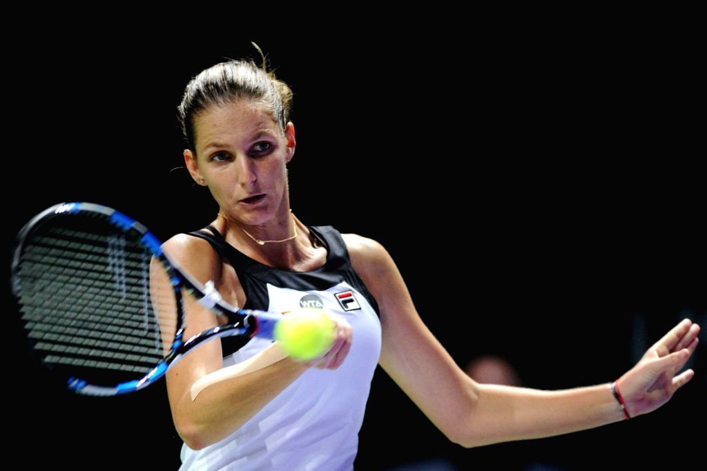 SINGAPORE, Oct. 28, 2016 - Karolina Pliskova of the Czech Republic competes during the WTA Finals round robin match against Agnieszka Radwanska of Poland at Singapore Indoor Stadium, Oct. 28, 2016. ...