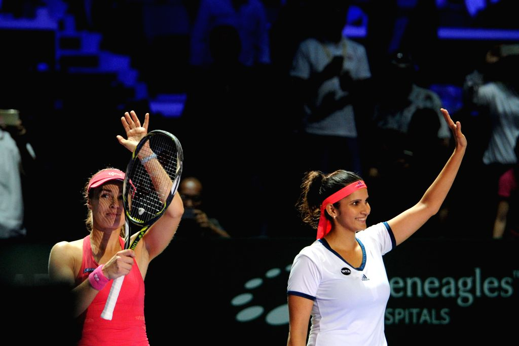 SINGAPORE, Oct. 28, 2016 - Martina Hingis (L) of Switzerland and Sania Mirza of India wave to the audience after winning the WTA Finals elimination match against Chan Yung-Jan and Chan Hao-Ching of ... - Martina Hingis and Sania Mirza