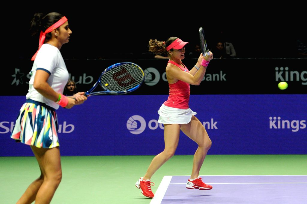SINGAPORE, Oct. 28, 2016 - Martina Hingis (R) of Switzerland and Sania Mirza of India compete during the WTA Finals elimination match against Chan Yung-Jan and Chan Hao-Ching of Chinese Taipei at ... - Martina Hingis and Sania Mirza