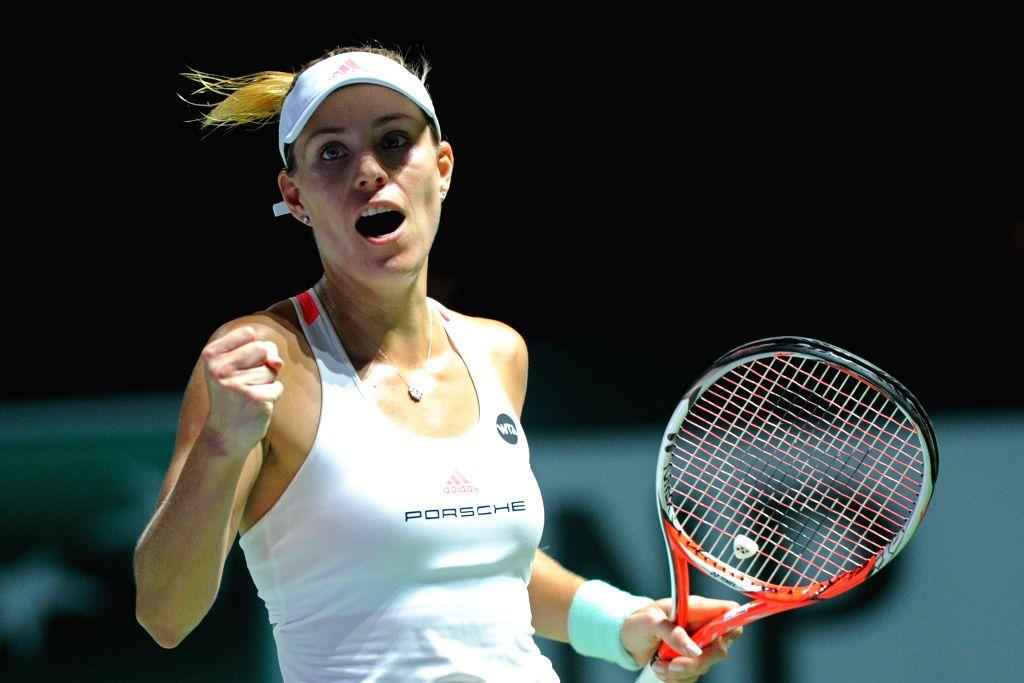 SINGAPORE, Oct. 29, 2016 - Angelique Kerber of Germany celebrates after winning the WTA Finals semi-final match against Agnieszka Radwanska of Poland at Singapore Indoor Stadium, Oct. 29, 2016. ...