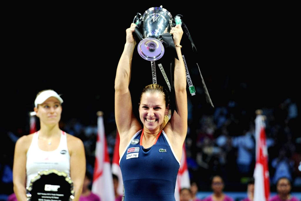 SINGAPORE, Oct. 30, 2016 - Dominika Cibulkova of Slovakia holds the trophy during the victory ceremony after winning the WTA Finals match against Angelique Kerber of Germany at Singapore Indoor ...