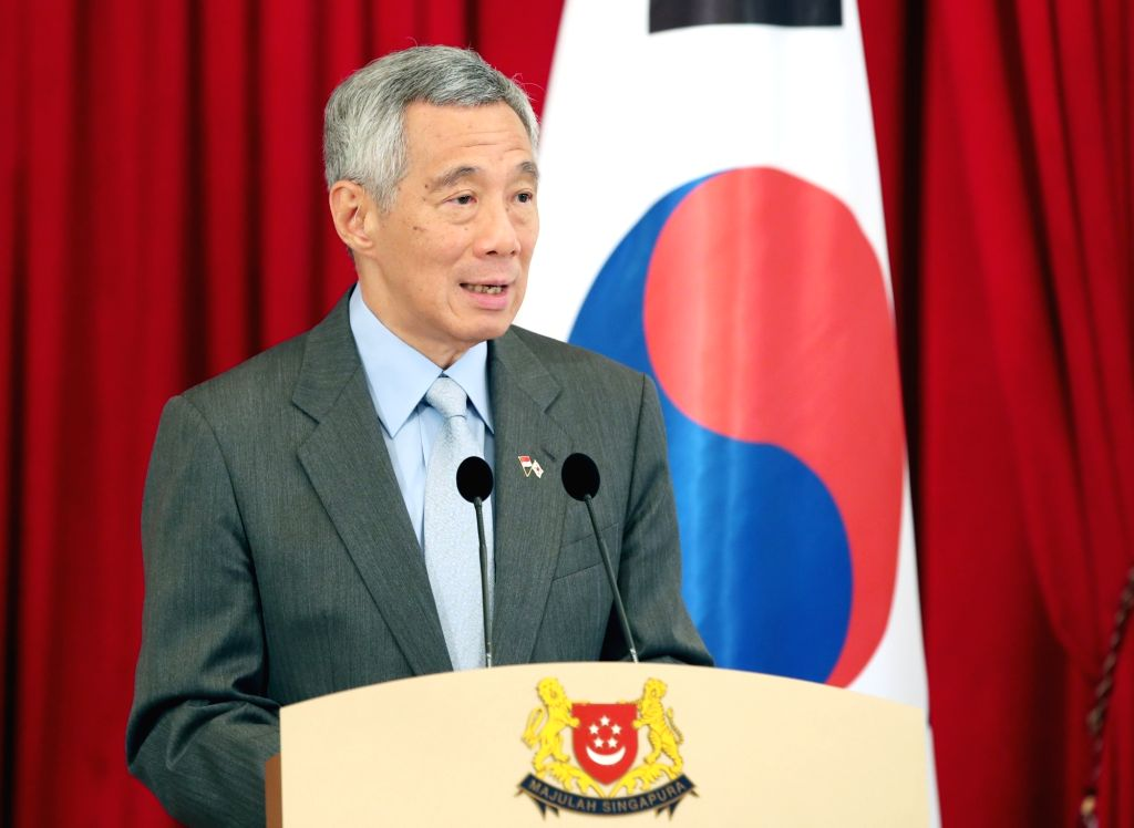 Singapore Prime Minister Lee Hsien Loong speaks during a joint press conference with South Korean President Moon Jae-in at the presidential palace in Singapore on July 12, 2018. Moon and ... - Lee Hsien Loong