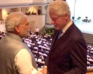 Prime Minister Narendra Modi meets former US president Bill Clinton in Singapore on March 29, 2015. - Narendra Modi