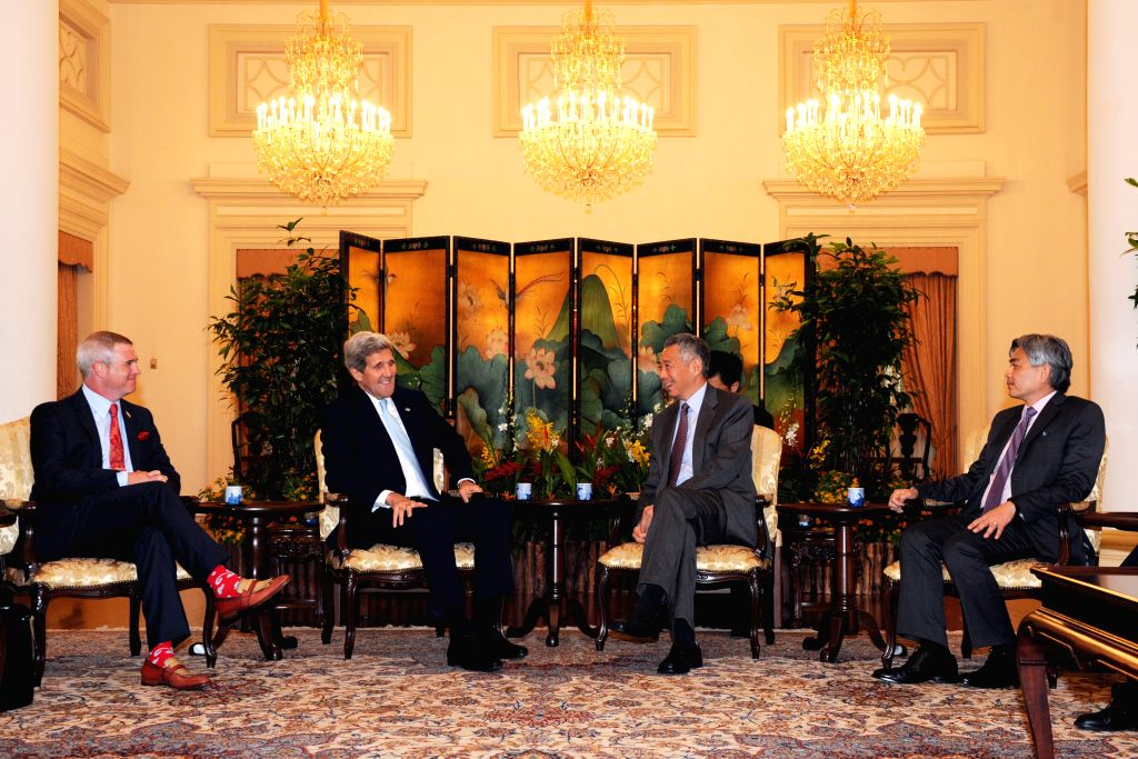 Singapore's Prime Minister Lee Hsien Loong (2nd R) meets with U.S. Secretary of State John Kerry (2nd L) at Singapore's Istana, Aug. 4, 2015. John Kerry is on a ... - Lee Hsien Loong