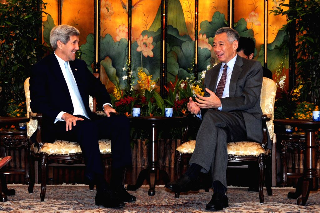 Singapore's Prime Minister Lee Hsien Loong (R) meets with U.S. Secretary of State John Kerry at Singapore's Istana, Aug. 4, 2015. John Kerry is on a one-day visit ... - Lee Hsien Loong
