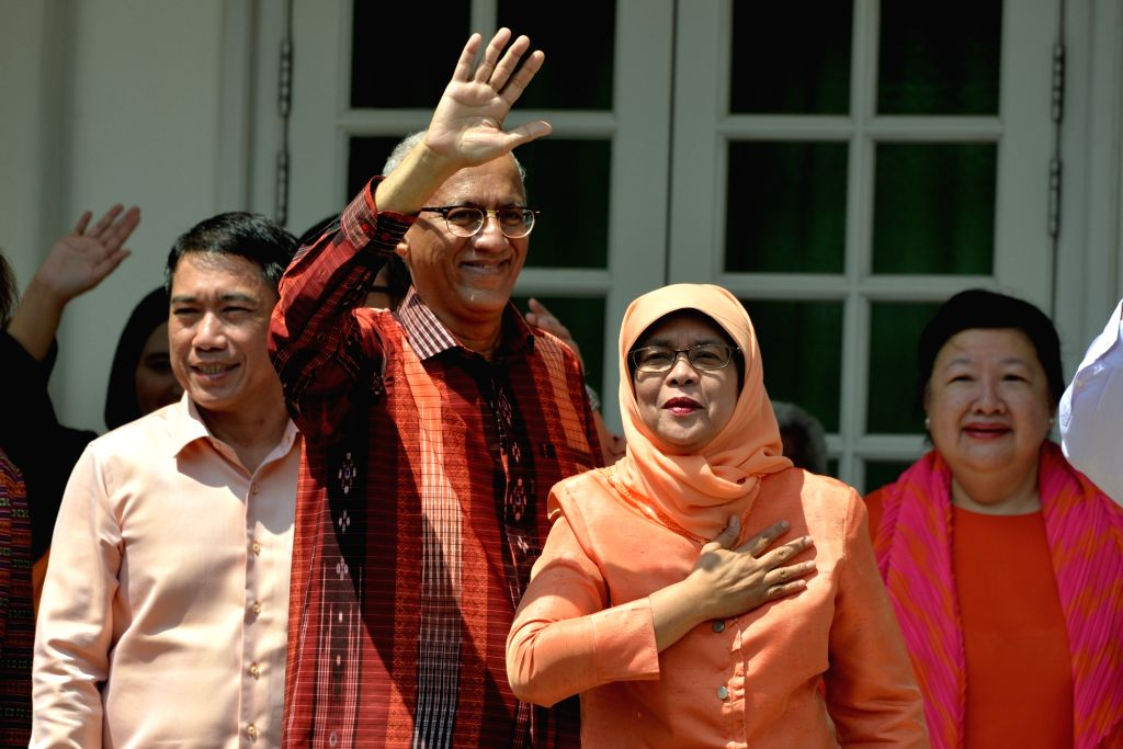 SINGAPORE, Sept. 13, 2017 - Former Speaker of Parliament Halimah Yacob (2nd R) greet her supporters at the People's Association headquarters in Singapore on Sept 13, 2017. Halimah Yacob was declared ...
