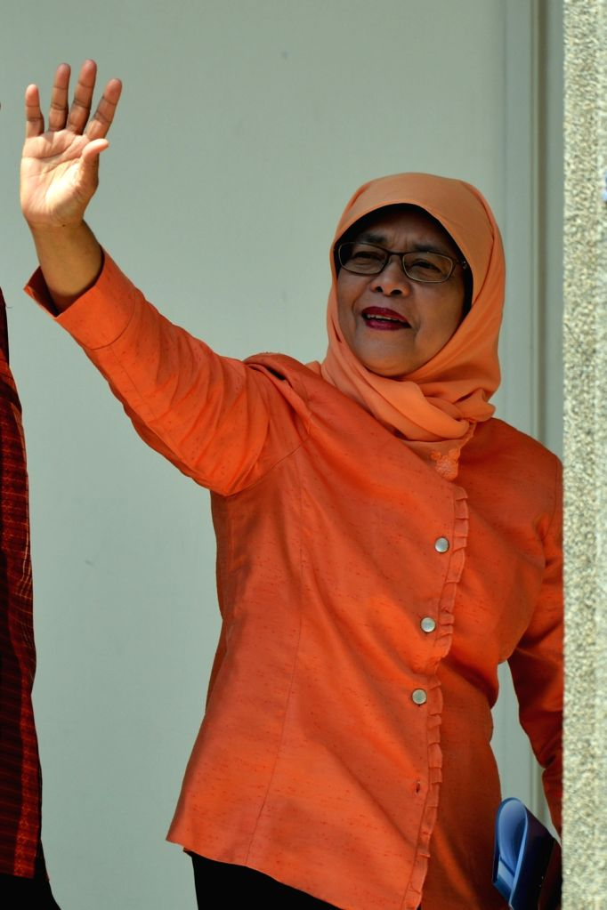 SINGAPORE, Sept. 13, 2017 - Former Speaker of Parliament Halimah Yacob greets her supporters at the People's Association headquarters in Singapore on Sept 13, 2017. Halimah Yacob was declared ...