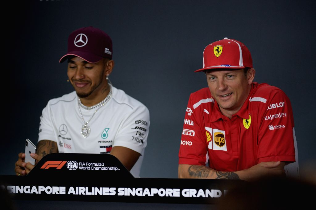 SINGAPORE, Sept. 13, 2018 - Lewis Hamilton (L) of Mercedes and Kimi Raikkonen of Ferrari attend the pre-race press conference of the F1 Singapore Grand Prix Night Race held in Singapore, on Sept. 13, ...