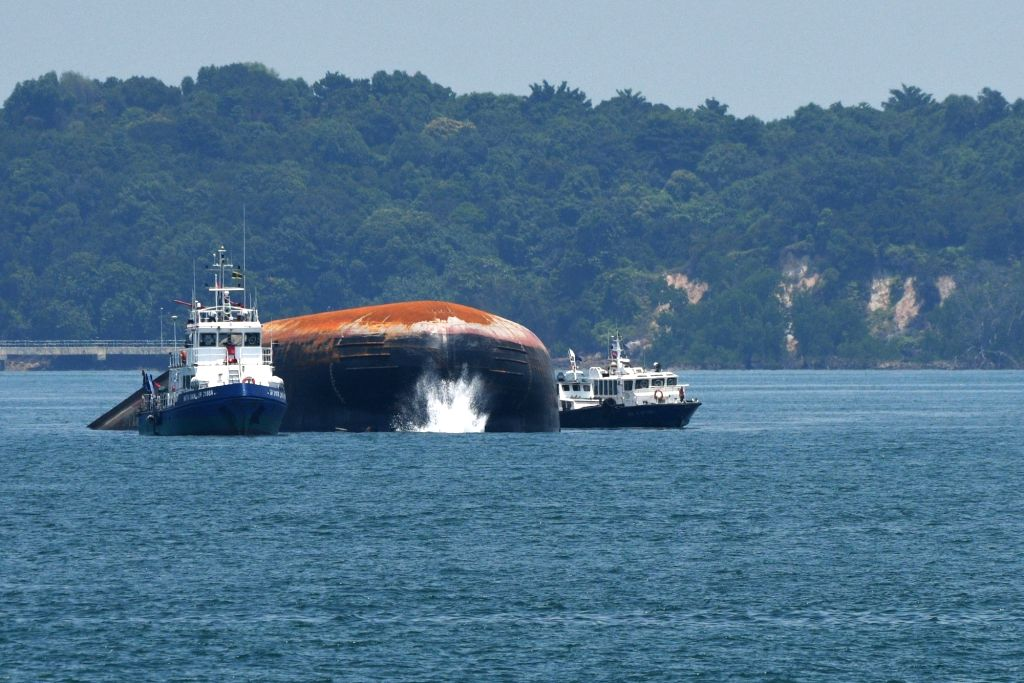 SINGAPORE, Sept. 14, 2017 - The submerged dredger (C) is seen in the west part of Singapore Strait on Sept. 14, 2017. The Maritime and Port Authority of Singapore (MPA) announced Wednesday evening ...