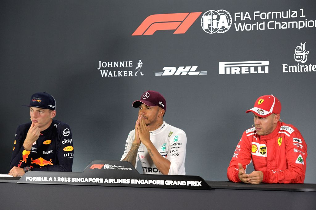 SINGAPORE, Sept. 15, 2018 - Mercedes' driver Lewis Hamilton (C) of Britain attends the press conference after the qualifying session of the Formula One Singapore Grand Prix Night Race held at the ...