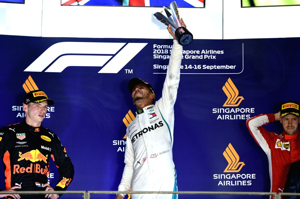 SINGAPORE, Sept. 16, 2018 - First-placed Mercedes' driver Lewis Hamilton (C) of Britain celebrates during the awarding ceremony of the 2018 Singapore Formula One Grand Prix held at the Marina Bay ...