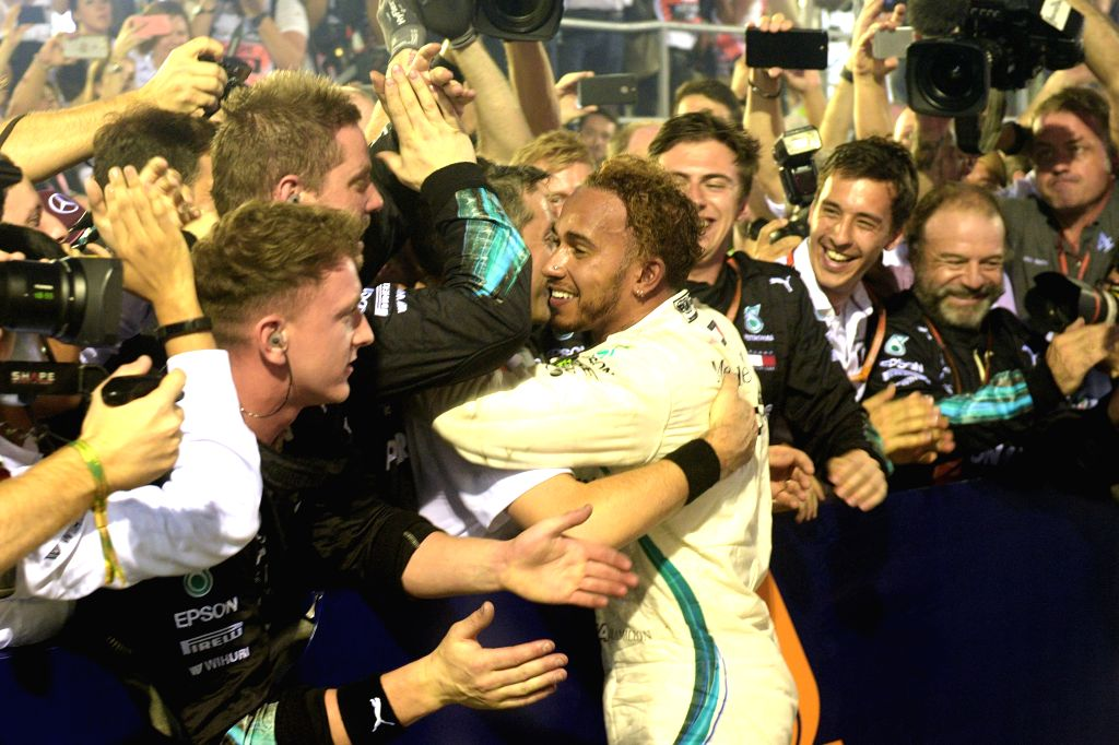 SINGAPORE, Sept. 16, 2018 - Mercedes driver Lewis Hamilton (C) of Britain celebrates with his team after winning the 2018 Singapore Formula One Grand Prix held at the Marina Bay Street Circuit in ...