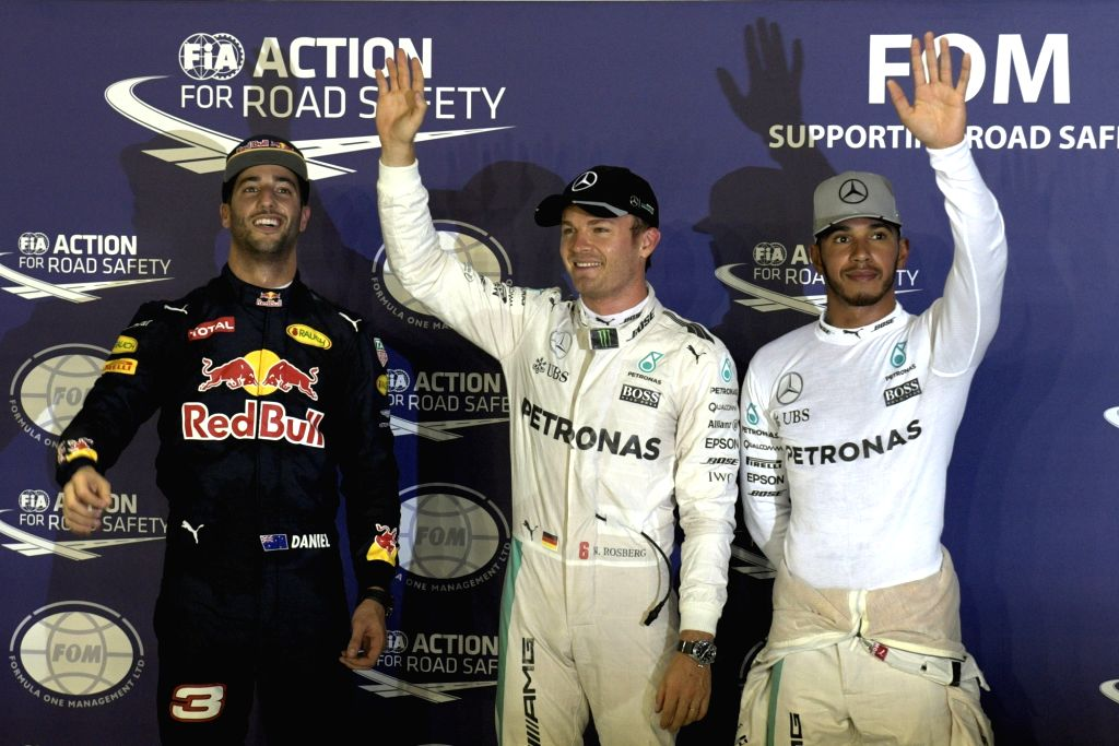 SINGAPORE, Sept. 17, 2016 - Mercedes driver Nico Rosberg (C) of Germany celebrates his pole position as he stands next to Red Bull driver Daniel Ricciardo (L) of Australia and Mercedes driver Lewis ...
