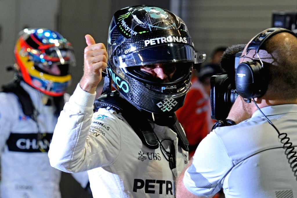 SINGAPORE, Sept. 17, 2016 - Mercedes driver Nico Rosberg of Germany (C) thumbs up after winning pole position during the qualifying session on Day 2 of 2016 Singapore F1 Grand Prix Night Race?Sept. ...