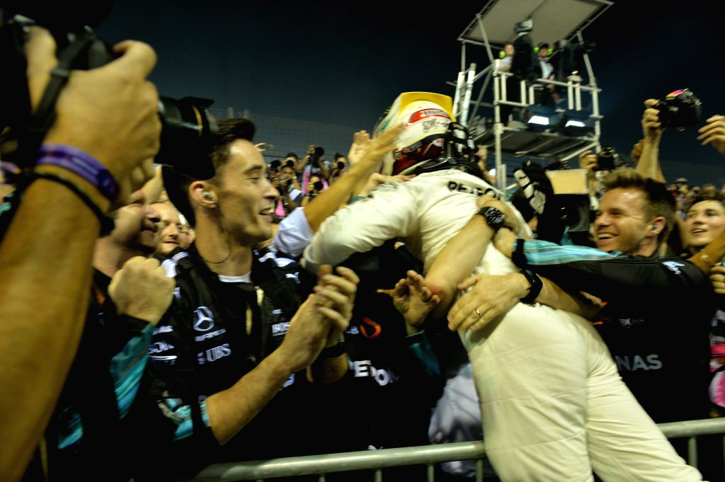 SINGAPORE, Sept. 17, 2017 - Mercedes' British driver Lewis Hamilton celebrates with teammates after winning the Formula One Singapore Grand Prix in Singapore on Sept. 17, 2017.