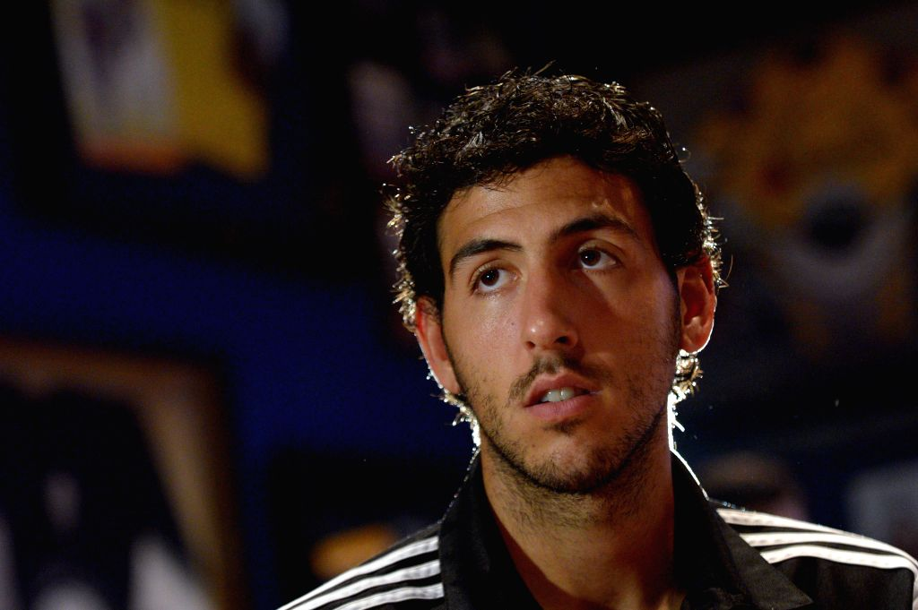 Spanish club Valencia's captain Dani Parejo attends the press conference in Singapore, Sept. 2, 2014. Singapore-based businessman Peter Lim is currently in talks . - Dani Parejo
