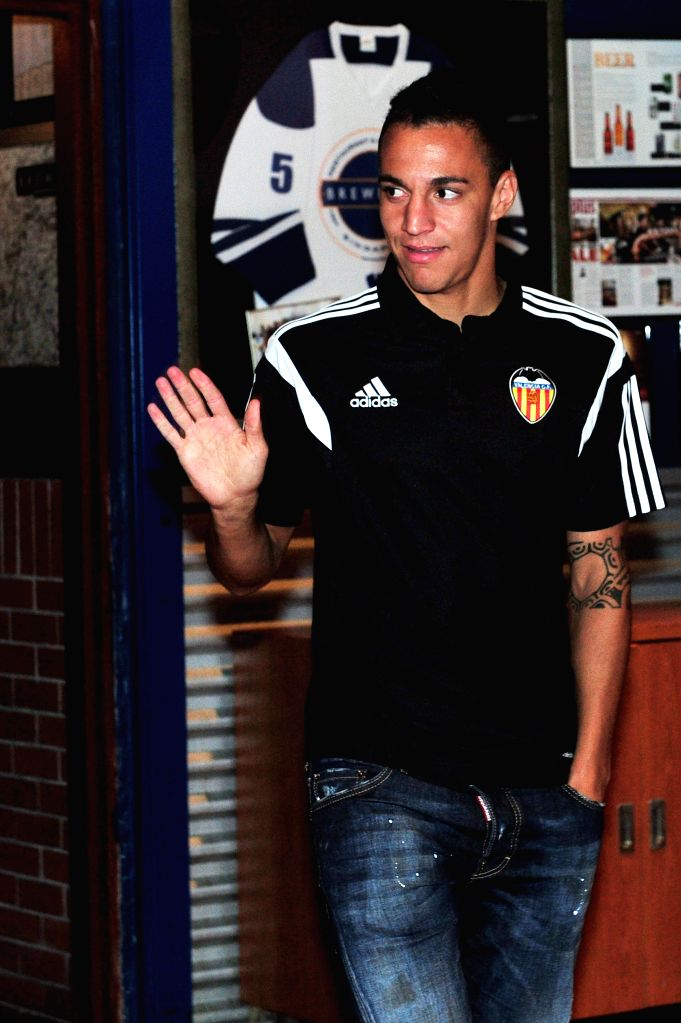 Spanish club Valencia's striker Rodrigo Moreno attends the press conference in Singapore, Sept. 2, 2014. Singapore-based businessman Peter Lim is currently in ...